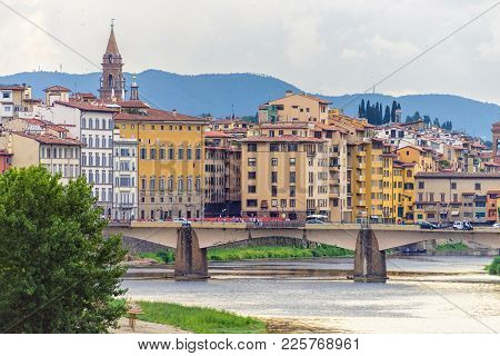 Daylight Cloudy Day View To Bridge Above Arno River With People Walking And Cars Riding