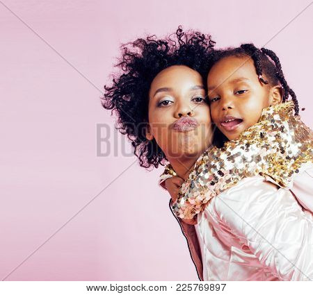 Young Pretty African-american Mother With Little Cute Daughter Hugging, Happy Smiling On Pink Backgr