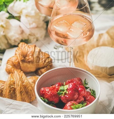 French Style Romantic Summer Picnic Setting. Flat-lay Of Glasses Of Rose Wine, Fresh Strawberries, C