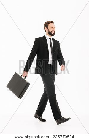Full-length photo of smiling ambitious man in business suit going on meeting with black diplomat in hand isolated over white background