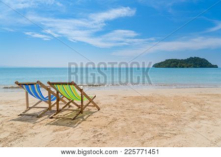 Two Beach Chairs On The White Sand With Blue Sky And Summer Sea Background. Summer, Vacation, Travel