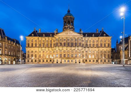 The Royal Palace In Dam Square At Amsterdam, Netherlands. Dam Square Is Famous Place In Amsterdam.