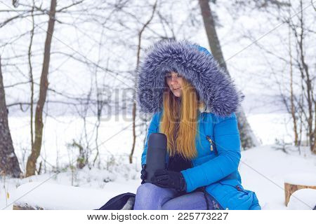 Woman With Thermos In Winter Forest / Woman Holding Thermos In Snowy Winter Forest