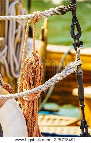 Old Fashioned Mast Rigging, Many Brown Ropes On Ship Sailing Boat Deck.
