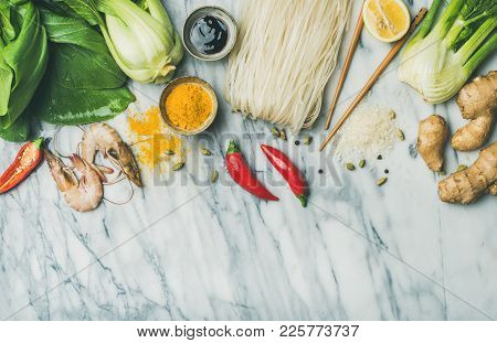 Asian Cuisine Ingredients Over Marble Background, Top View, Copy Space. Flat-lay Of Vegetables, Spic