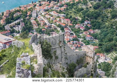 Aerial View From Walls Of St John Fortress In Kotor With Dobrota Town On Background, Montenegro
