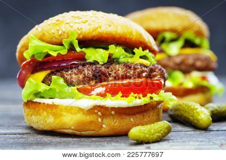 Two Delicious Beef Burgers, With Cheese, Vegetables And Lettuce, Hand Made, According To A Classic R