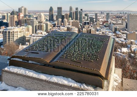 Montreal, Ca - 8 February 2018: Downtown Montreal And Plaque Of Jacques Cartier Located At The Summi