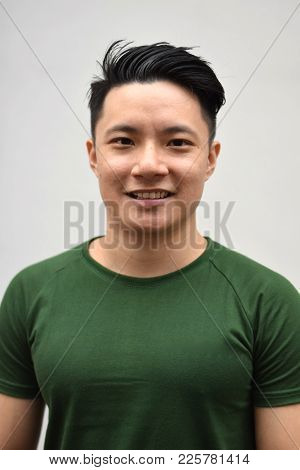 A Young Handsome Asian Chinese Smiling Posing For The Camera