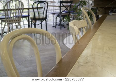 White Wooden Chairs And Clean Table, Stock Photo