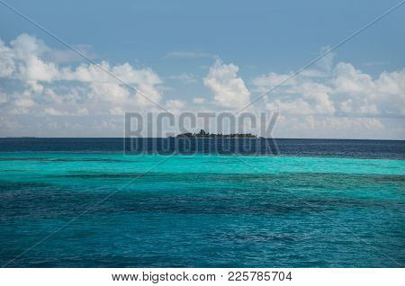 Sea Water Is A Dark Aquamarine Color With Stripes Of Light Water Where The Coral Reefs Come To The S