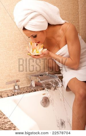 Beautiful young ethnic woman in bathroom