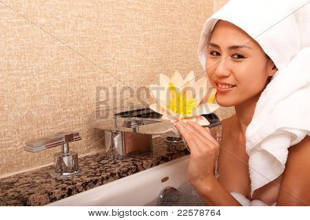 Beautiful japanese woman in bathroom with towels