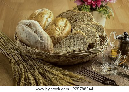 Fresh Bread And Wheat With Tea On The Wooden