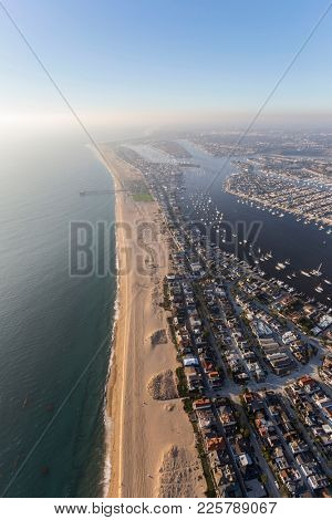 Aerial view of foggy afternoon sunshine along the pacific coast at Newport Beach in Orange County California.