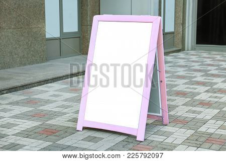 Advertising sidewalk board outdoors