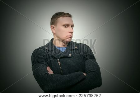 The Disgruntled, Disappointed And Offended Man Looks Reproachfully And Does Not Want To Hear Anythin