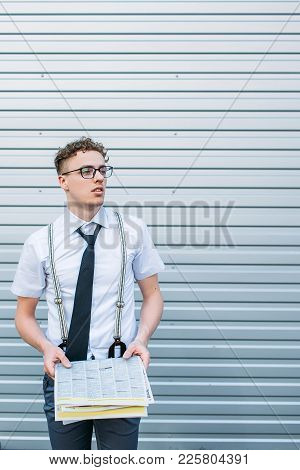 Information. Unexpected News. Puzzled Confused Business Man Holding Newspaper Is At Loss. Free Space