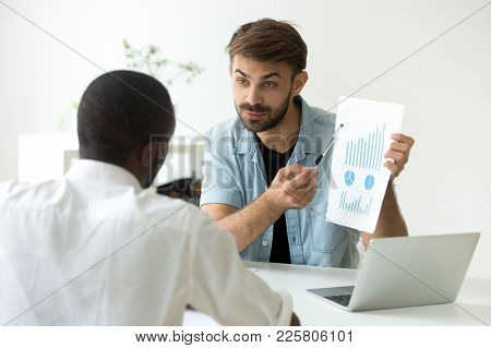 Financial Advisor Holding Statistics Showing Rising Charts Graphs Convincing African Businessman To