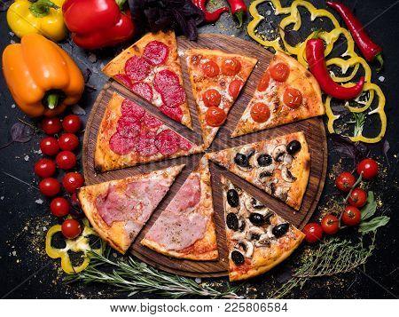 Traditional Italian Food Cuisine. Delicious Pizza Slice Quattro Stagioni With Ham Prosciutto Tomatoe