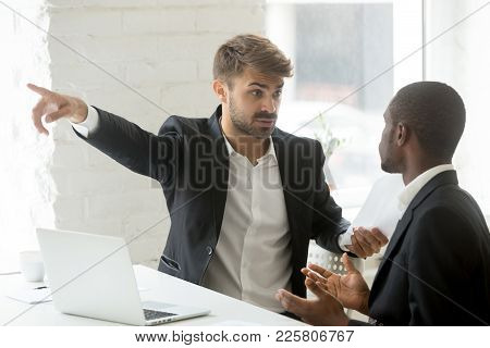 Angry Rude Caucasian Executive Firing Male Incompetent African Employee For Bad Work, Impolite White