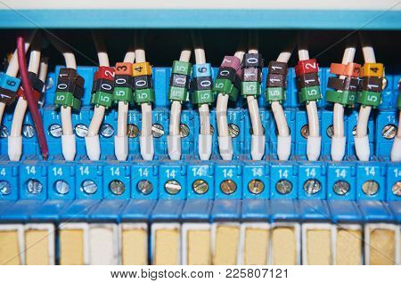 Many Intermediate Relays Installed In A Row. They Are Connected With Many Wires Red With Marking. Wi