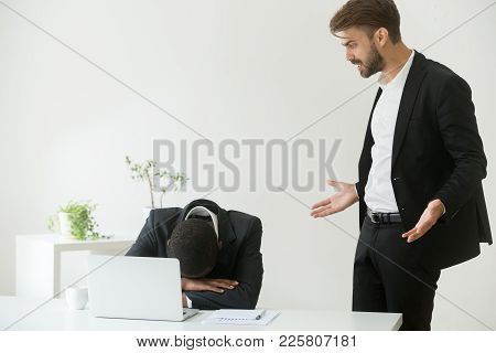 Angry Mean Caucasian Boss Shouting Scolding Frustrated Incompetent African American Employee For Bad