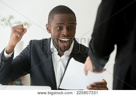 Excited African American Employee Receives Notice About Promotion Reward Achievement At Workplace, B