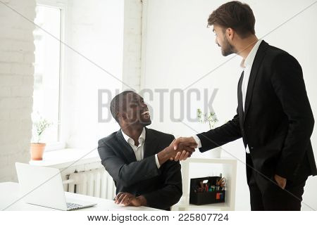 Grateful Caucasian Executive Handshaking Happy African Employee Giving Positive Feedback Congratulat