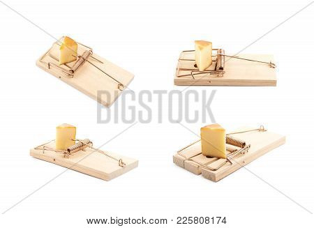 Wooden Mousetrap With A Piece Of Cheese Inside, Composition Isolated Over The White Background, Set
