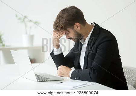 Depressed Unsuccessful Businessman Feels Terrible Headache, Distraught Stressed Entrepreneur Regrets