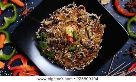 Meal Recipe. Food Ingredients And Cooking Process. Japanese Cuisine. Buckwheat Noodles Meat And Vege