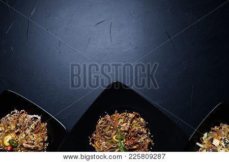 Oriental Restaurant Family Dinner. Menu Meal Assortment. Meat And Veggie Salads For Balanced Nutriti
