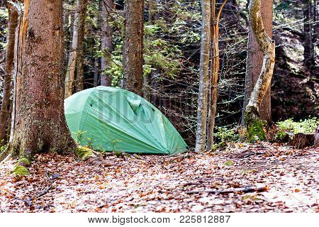Tent In The Forest In The Clearing. Midnight Clearing And A Tourist Tent. Rest, Trekking In The Fore