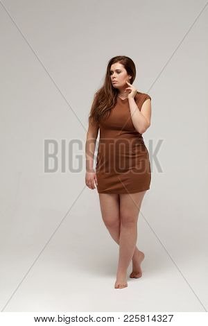 Full Length Portrait Of Beautiful Chubby Woman. Isolated On White Background.