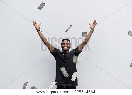 A wealthy African man throwing away his money