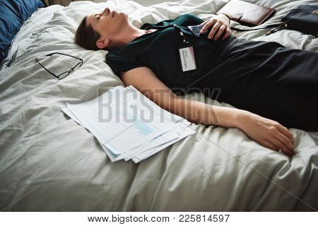 A woman passing out in bed