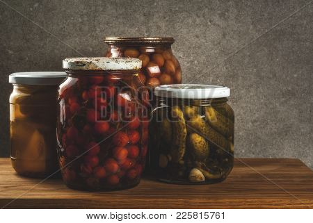 Homemade Preserving, Canning Food, Pickled Or Fermented Vegetables In Glass Jars Over Kitchen Drawer
