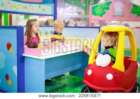 Child Playing In Toy Shop Or Restaurant. Educational Toys And Role Game For Kids. Kindergarten Or Pr