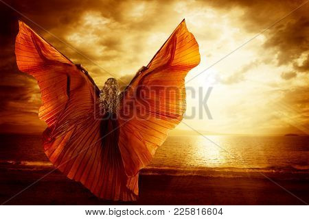 Woman Dancing Wings Dress, Fashion Art Model Flying On Ocean Sky Sunset, Beauty Imagination Concept