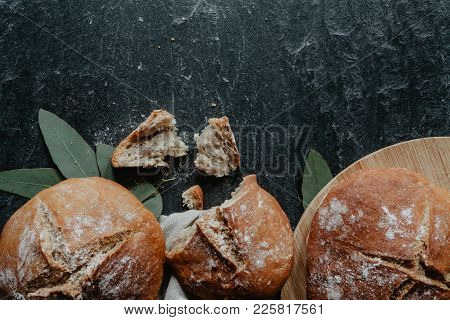 Homemade Loaf Of Irish Soda Bread With Eucalyptus Leaves On Black Stone
