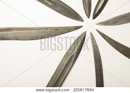 Collection Of Knife Or Dagger Blades And Swords Arranged In Pointing Towards The Center. Old  Knives