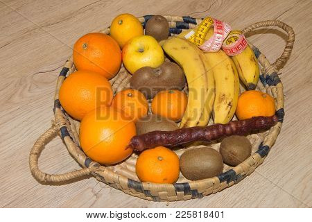 Concept Diet And Weight Loss On Wooden Table. Products With Low Fat Content. Fruits And Measuring Ta