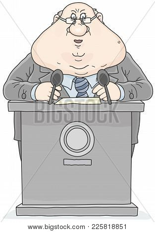 Politician Standing Behind A Rostrum And Giving A Speech