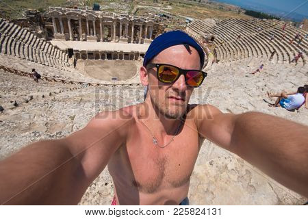 Selfie photo in amphitheatre in the ruins of Hierapolis, in Pamukkale, Turkey.