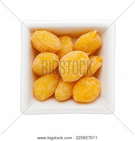 Pieces Of Preserved Peach In A Square Bowl Isolated On White Background