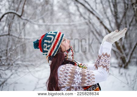 Photo Of Smiling Girl In Knitted Hat And Scarf Catching Snowflakes In Winter Forest During Day, Defo