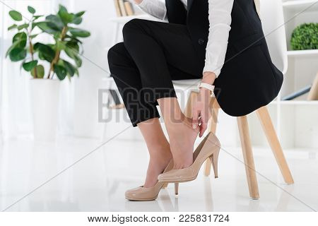 Partial View Of Businesswoman Sitting At Workplace In Office