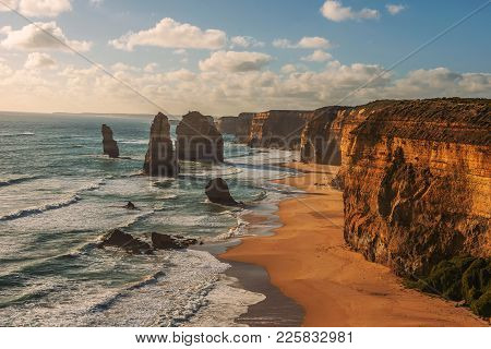 Sunset Over The Twelve Apostles Along The Famous Great Ocean Road In Victoria, Australia, Near Port