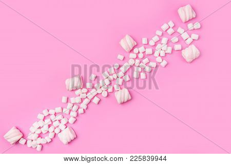 Marshmallows On Pink Background With Copyspace. Flat Lay Or Top View. Background Or Texture Of Color